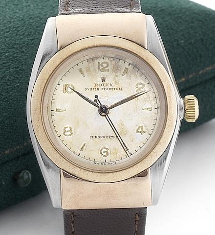 Rolex. A fine and rare stainless steel and gold automatic centre seconds wristwatch with hooded lugs Oyster Perpetual, Ref:3065, Movement No.50724, Circa 1933