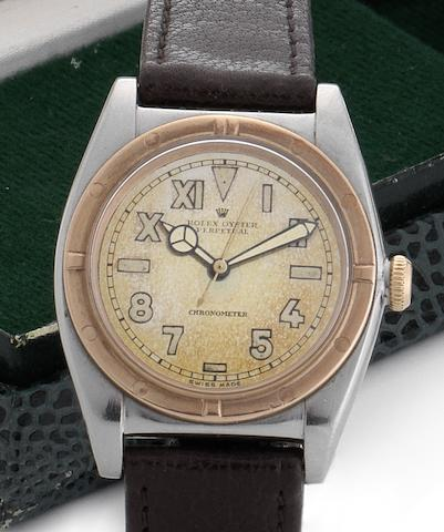 Rolex. A fine stainless steel and rose gold automatic wristwatch  Oyster Perpetual, Ref:3372, Circa 1940