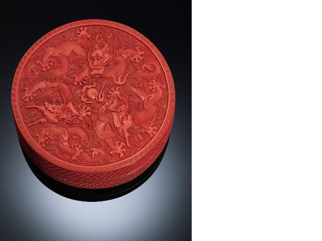 A circular cinnabar lacquer 'dragons' box and cover Qianlong period