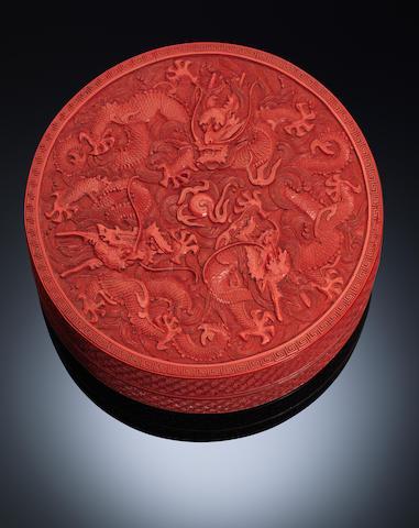 A circular cinnabar lacquer 'dragons' box and cover Qianlong period
