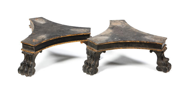 A pair of 19th Century ebonised and gilt-highlighted triangular plinths or bases