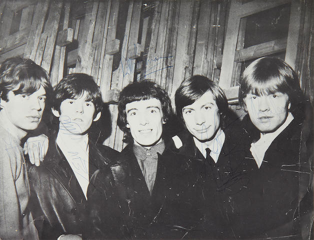 A large autographed photograph of the Rolling Stones, circa 1964,