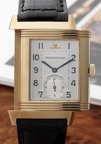 Jaeger-LeCoultre. A very fine 18ct gold limted edition tourbillon reversible wristwatch with power reserve, together with presentation box and papersNo.15/500, Sold in 1993