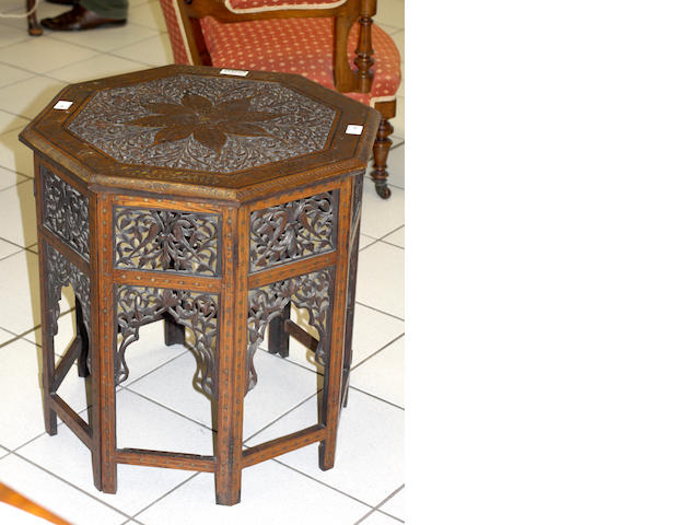 An Indian brass inlaid hardwood octagonal table
