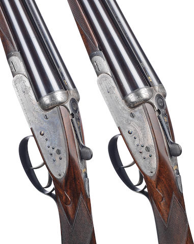 A pair of 12-bore sidelock ejector guns by Harrison & Hussey, no. 3464/5 In a relined brass-mounted oak and leather case with Harrison & Hussey trade-label and together with a pair of leather single-gunslips