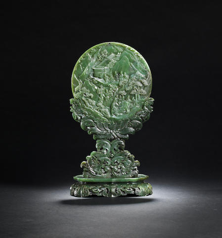 A rare and exquisite spinach green jade 'Yuanxiao Festival' circular table screen and stand Qianlong