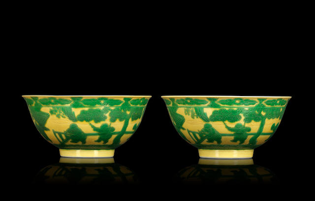 A pair of green-enamelled on yellow ground 'playing boys' bowls Yongzheng six-character mark and of the period
