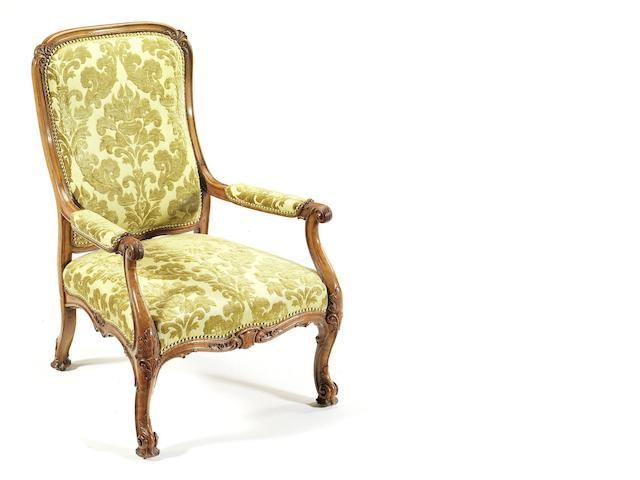 An early Victorian carved satin-birch armchair  by Gillows