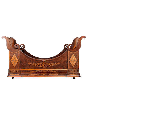 An early 19th Century marquetry inlaid Lit en Bateau