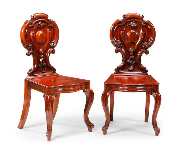 A pair of mid-Victorian mahogany hall chairs