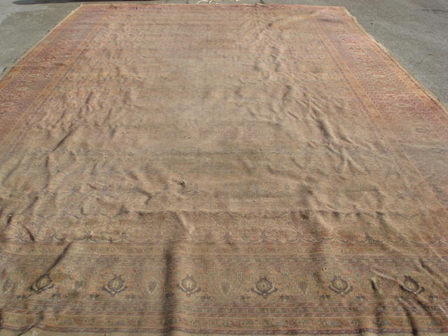 A large Indian carpet 609cm x 365cm