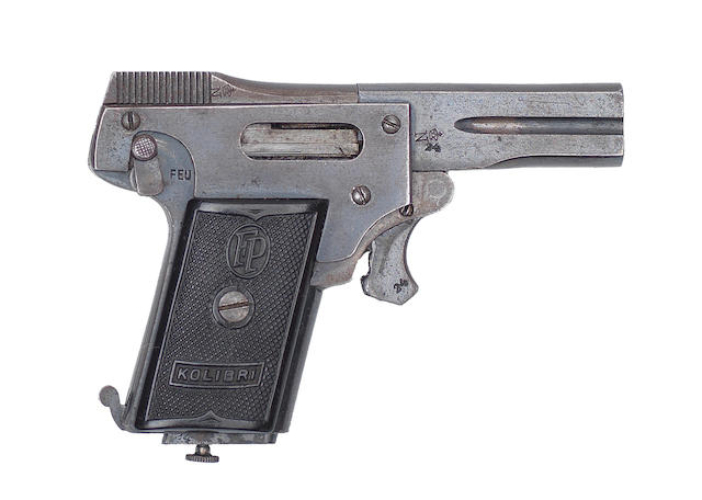 A rare Kolibri 2.7mm miniature semi-automatic pistol, no. 24 In a later leather pouch