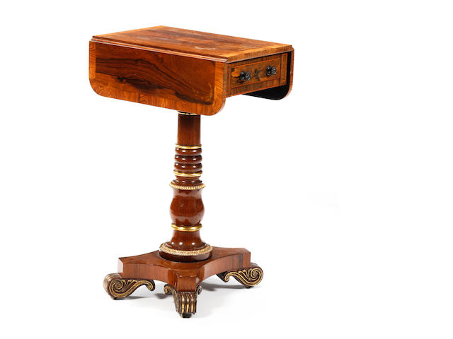 A rosewood and gilt-decorated drop-leaf pedestal work table