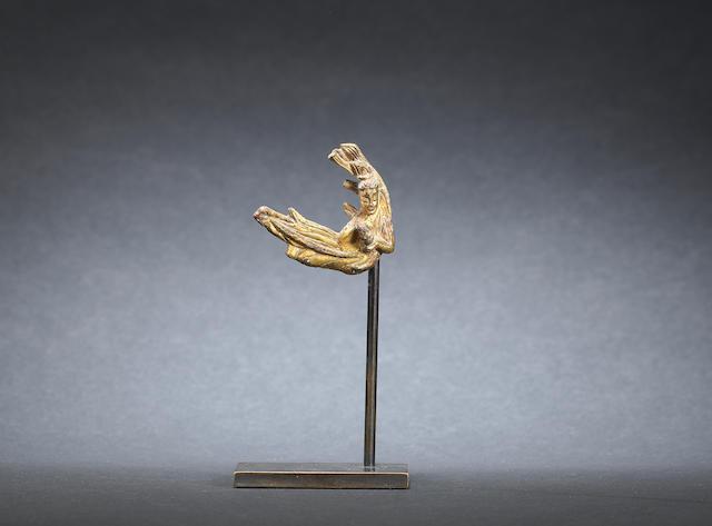 A gilt-bronze figure of an apsara Northern Wei Dynasty