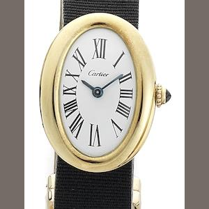 Cartier. A lady's 18ct gold manual wind oval wristwatch Baignoire, London hallmark for 1968