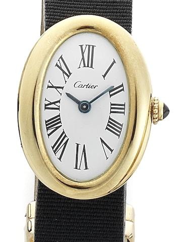 Cartier. A lady's 18ct gold manual wind oval wristwatchBaignoire, London Hallmark for 1968