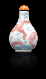 A puce and blue-enamelled porcelain 'dragon' snuff bottle Qianlong four-character seal mark and of the period