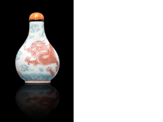 A iron-red and blue enameled snuff bottle, Qianlong mark and period Daoguang, Qianlong mark