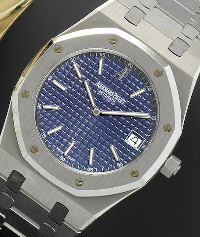 Audemars Piguet. A stainless steel automatic calendar bracelet watch together with box and papers Royal Oak, F37730, Sold 1997