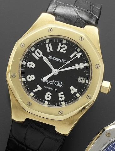 Audemars Piguet. An 18ct gold automatic calendar wristwatch together with Audemars Piguet boxRoyal Oak, No.1258, E31489, Circa 1995