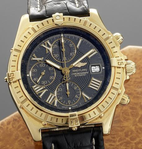 Breitling. An 18ct gold automatic chronograph wristwatch together with box and papersCrosswind Cronograph, Ref:K13055 1312, Sold 16th of December 2000