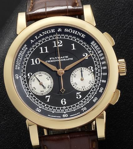 A. Lange & Söhne. A fine 18ct rose gold manual wind chronograph wristwatch together with fitted box and guarantee booklet1815 Flyback, Ref:401.031, Case No.153524, Movement No.45917, Sold 26th January 2007