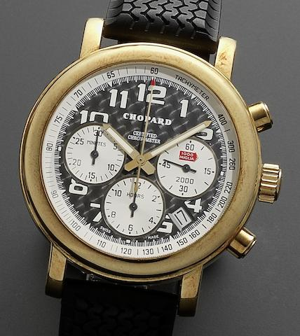 Chopard. An 18ct gold automatic chronograph calendar wristwatchMille Miglia 2000, Ref:1251, Case No.774503, Movement No.001709, Numbered 234/250, Circa 2000