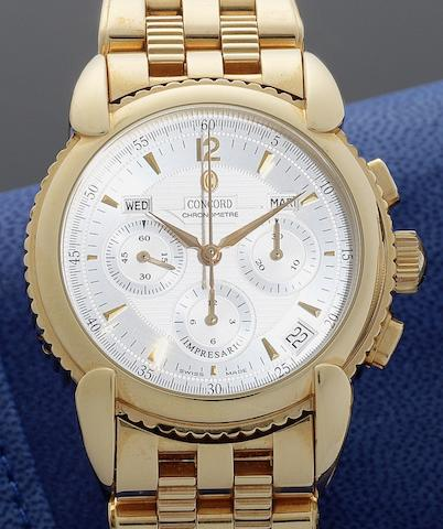 Concord. An 18ct gold automatic chronograph calendar bracelet watch together with fitted blue presentation box and Guarantee card Impresario, Movement No.116424, Certificate No.5720621, Circa 2002