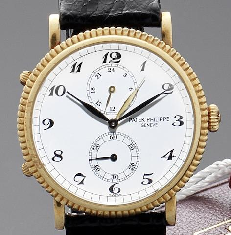 Patek Philippe. A fine 18ct gold two time zone wristwatch with Patek Philippe boxRef:5034, Travel Time, Case No.4036413, Movement No.3080259, Circa 1990