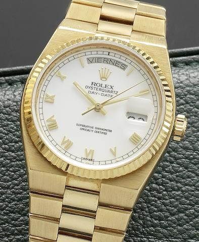 Rolex. A fine 18ct gold quartz calendar bracelet watch Oysterquartz Day-Date, Ref:19018, Case No.5723846, Circa 1979