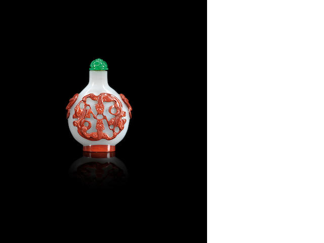 A cinnabar on glass overlay snuff bottle Qing dynasty