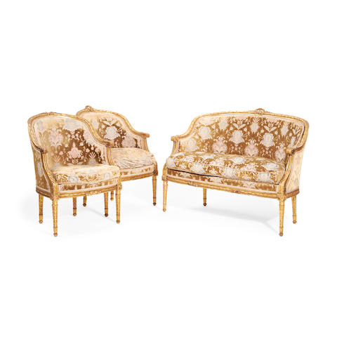 A three piece suite of French late 19th/early 20th century giltwood salon furniture in the Louis XVI style