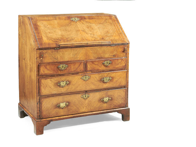 A George II walnut and featherbanded bureau