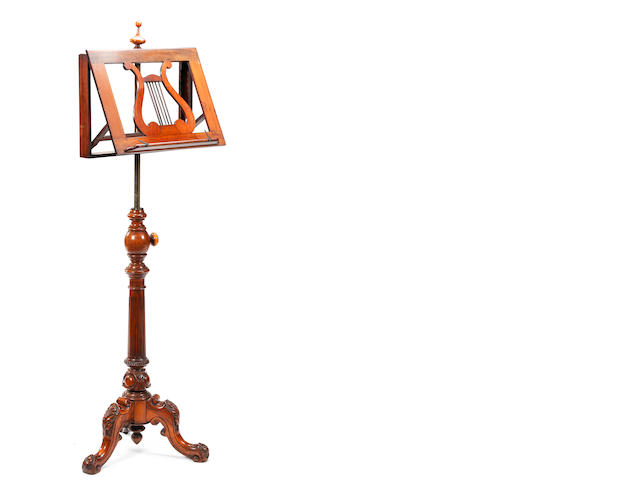 A mid-Victorian carved walnut pedestal music stand