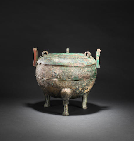An archaic bronze ritual tripod vessel and cover, ding  Eastern Zhou dynasty