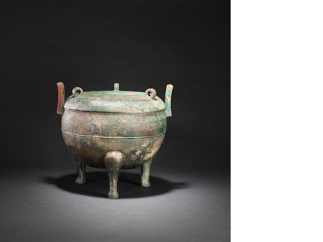 An archaic bronze tripod and cover, ding  Eastern Zhou