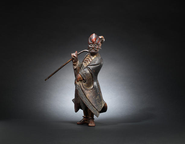 A gilt-lacquer wood figure of a luohan Late Ming dynasty