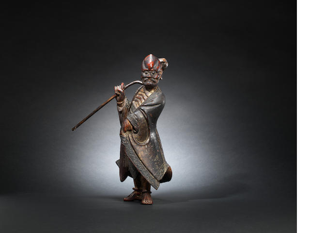 A gilt-lacquer wood figure of a luohan