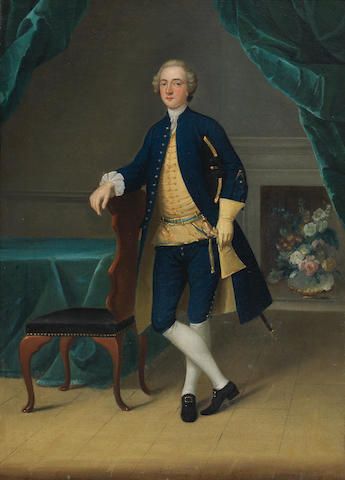 Arthur Devis (Preston 1712-1787 Brighton) Portrait of Mr. Thomas, full-length, in a blue coat and yellow waistcoat, standing in an interior