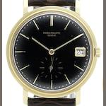 Patek Philippe. An 18ct gold automatic calendar wristwatch with certificate together with Extract from Archives Ref:3445, Case No.317838, Movement No.1122654, Circa 1962