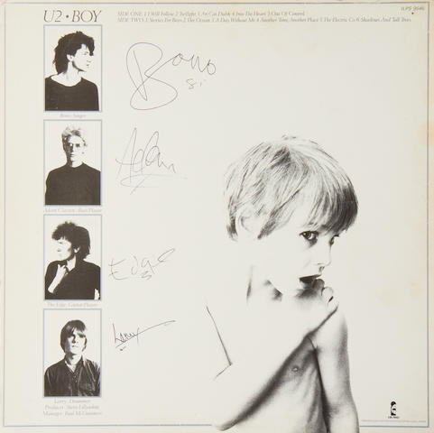 U2: An autographed cover of the album 'Boy' by U2,