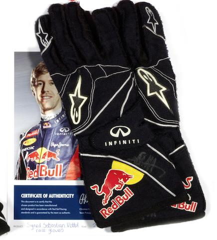 A signed pair of Sebastian Vettel gloves worn at the 2012 Australian Grand Prix,