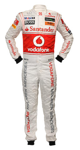 A signed Jenson Button race suit worn at the 2011 Turkish Grand Prix,