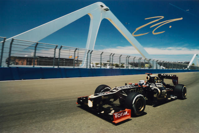 A signed Kimi Raikkonen photograph taken by Mark Thompson,