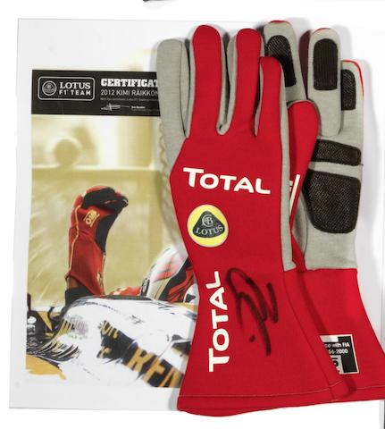 A signed pair of Kimi Raikkonen  gloves, 2012 season,