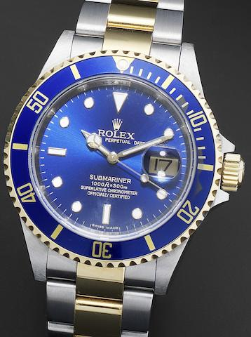 Rolex. A stainless steel and gold automatic calendar bracelet watch together with fitted box and papersSubmariner Ref:16613, Serial No.M842***, Sold 1st September 2009