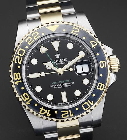 Rolex. A fine steel and gold automatic calendar bracelet watch with dual time zone indication GMT-Master Ref:116713, Serial No.V011***, Circa 2008