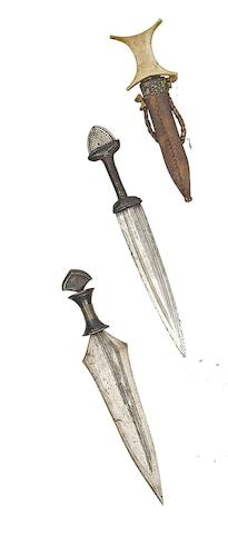 A North African Arm Dagger, A Congolese (Stanley Falls) Dagger, And An Equatorial African Dagger