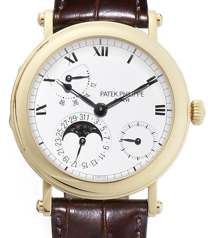 Patek Philippe. A fine 18ct gold automatic calendar wristwatch with power reserve, together fitted box and Certificate of OriginRef:5054J, Case No.4116766, Movement No.3165551, Sold 29th of August 2002