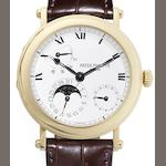 Patek Philippe. A fine 18ct gold automatic calendar wristwatch with power reserve, together fitted box and Certificate of Origin Ref:5054J, Case No.4116766, Movement No.3165551, Sold 29th of August 2002